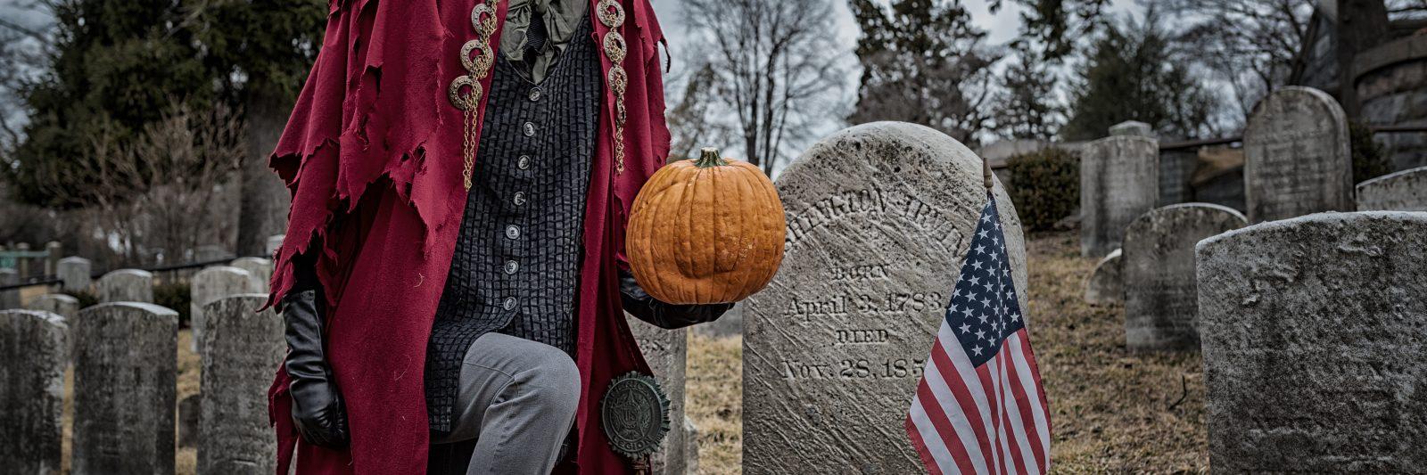 Headless Horseman kneeling at grave of Washington Irving