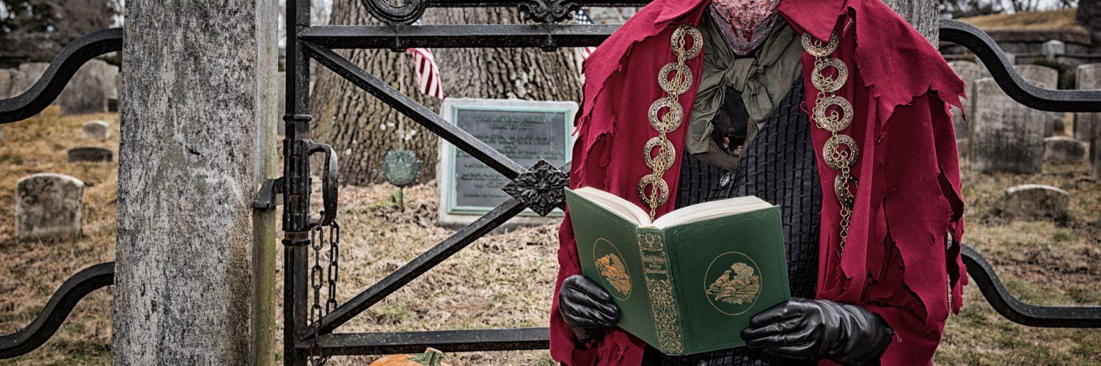 Headless Horseman reading The Legend of Sleepy Hollow at grave of Washington Irving