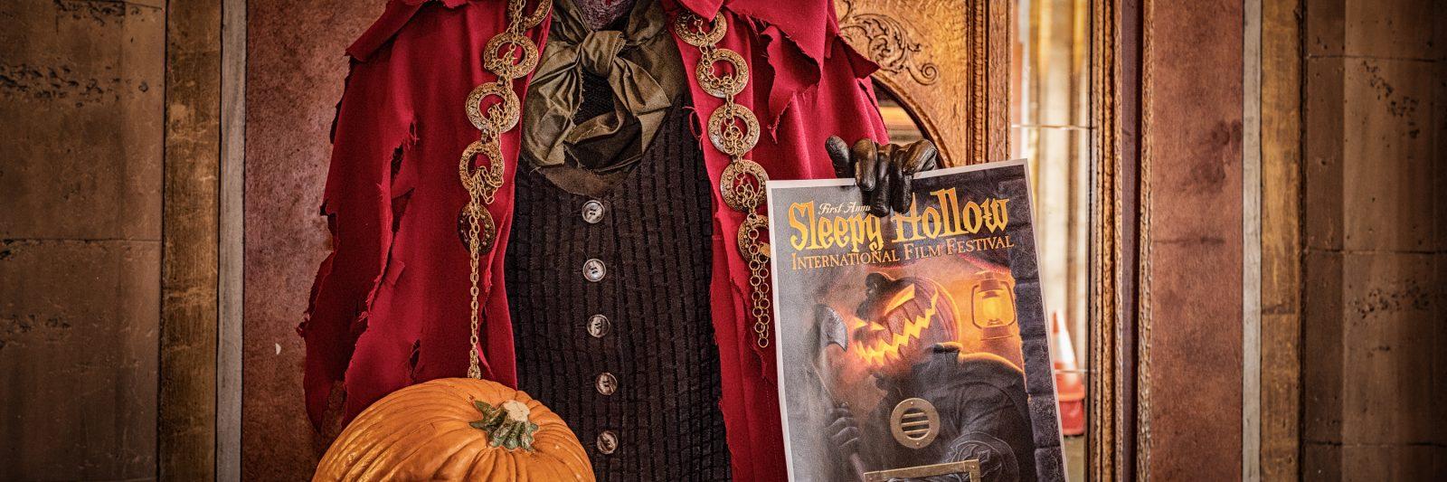 The headless horseman holds a poster for Sleepy Hollow International Film Festival.