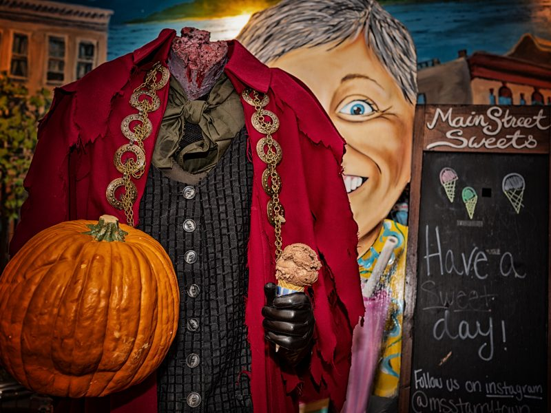 The headless horseman holds a pumpkin and ice cream cone at Main Street Sweets in Tarrytown, NY.