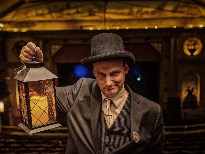 Actor David Neilsen hoists a lantern while portraying a ghoulish guide during Tarrytown Music Hall Ghost Tours.