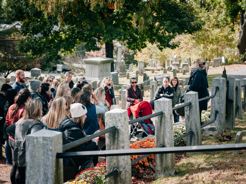 A Sleepy Hollow Cemetery walking tour stops to visit the grave of author Washington Irving.