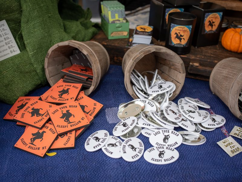 Headless horseman buttons and coasters displayed for sale at Sleepy Hollow street fair.