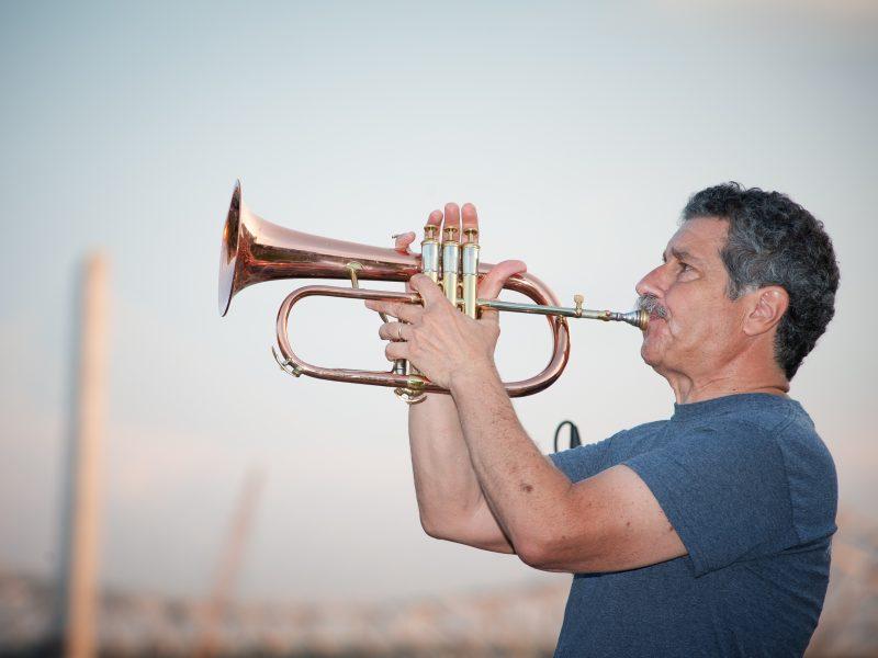 Portrait of jazz musician Mark Morganelli with his flugelhorn.