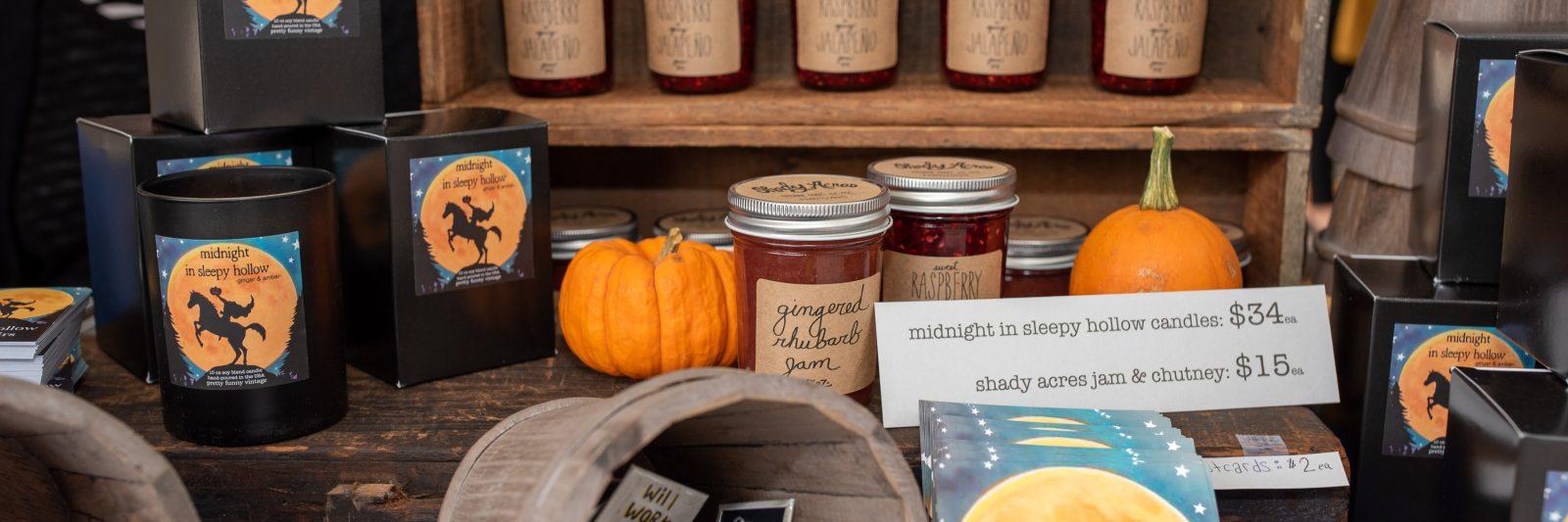 Jams, chutneys, and candles displayed at Sleepy Hollow street fair.