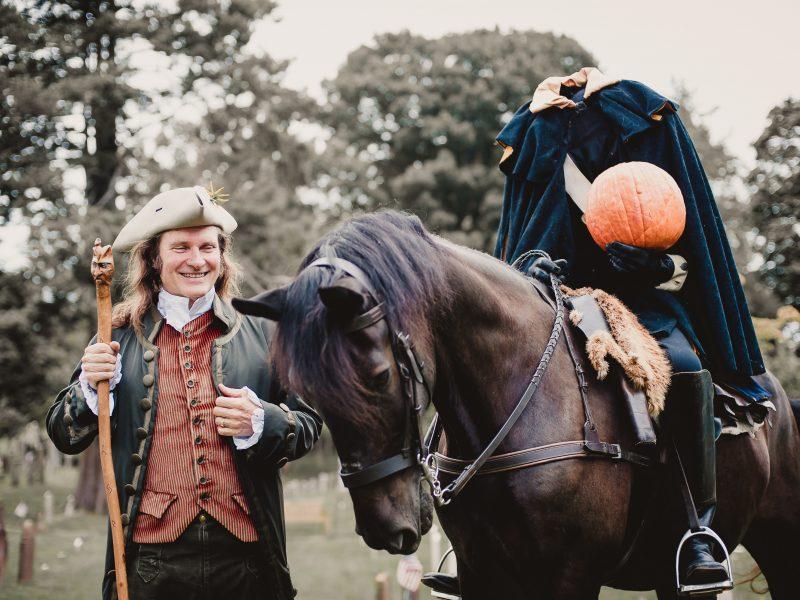Storyteller Jonathan Kruk walks alongside the headless horseman in the Old Dutch Burying Ground of Sleepy Hollow.