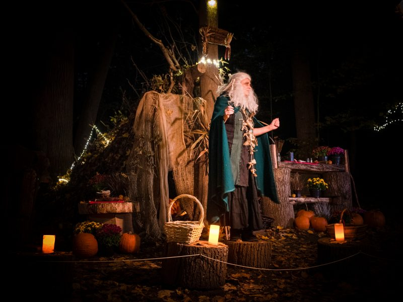 An actor portrays Hulda of Bohemia during a performance at night in Rockefeller State Park Preserve.