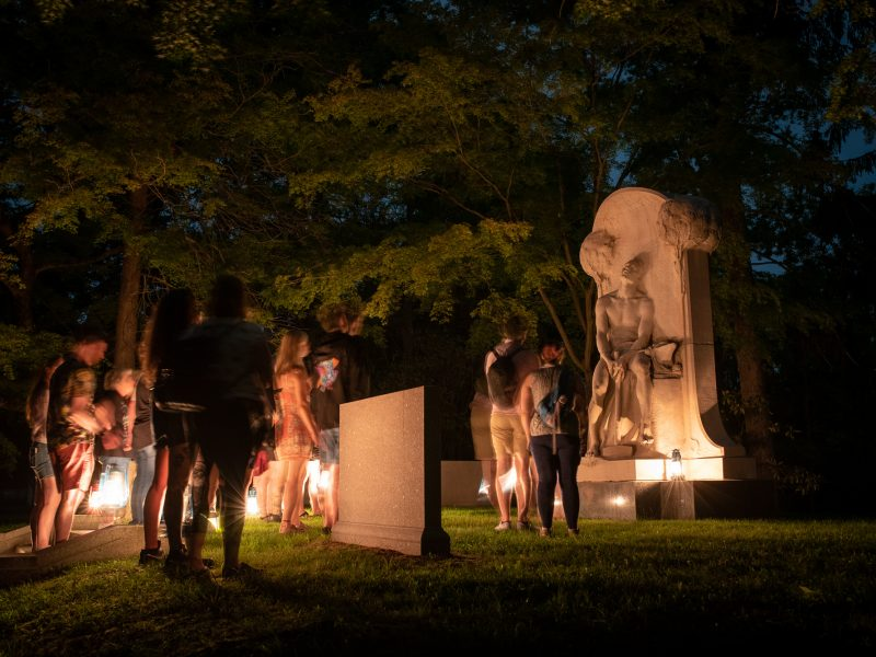 A Sleepy Hollow Cemetery lantern tour pauses at the monument of Henry Villard.