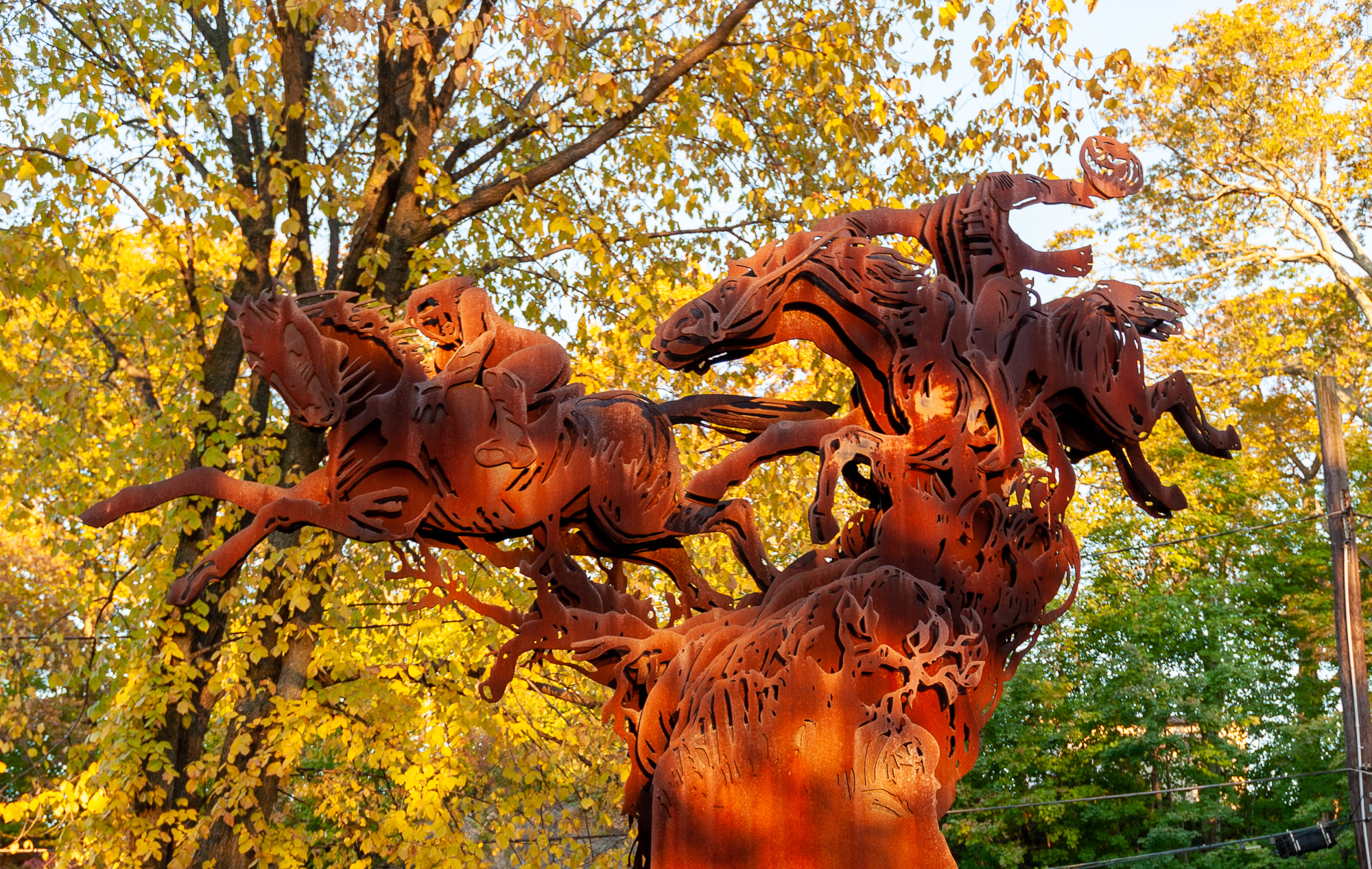 The steel sculpture of the headless horseman and Ichabod Crane stands alongside Route 9 in Sleepy Hollow, NY.