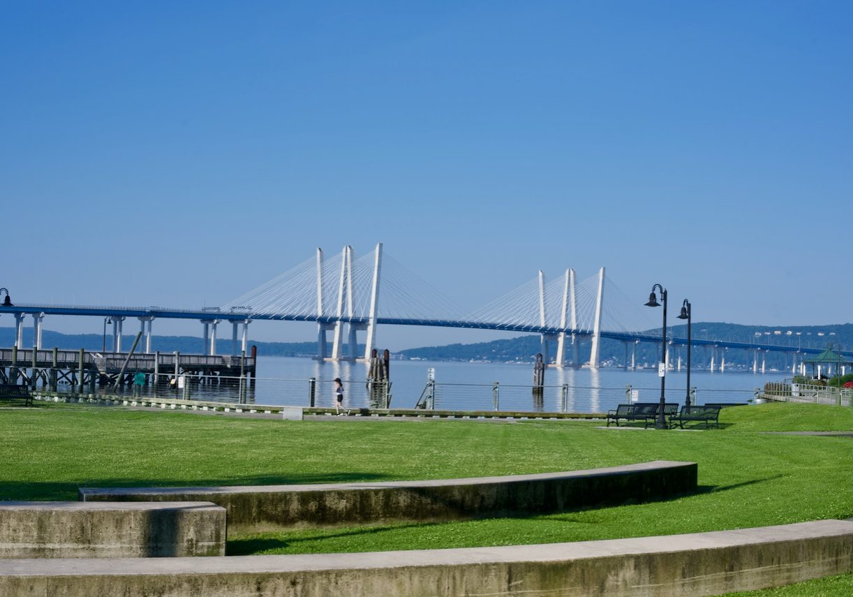 The lawn at Horan's Landing park in Sleepy Hollow, New York, with Mario Cuomo Bridge in background.